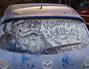 Santa drawn in dirt on back of car